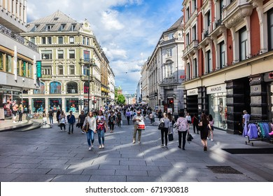 OSLO, NORWAY - JUNE 14, 2017: Tourists and locals walk in the Oslo city center streets.