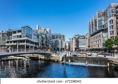 OSLO, NORWAY - JUNE 14, 2017: Aker Brygge district and Bryggetorget Square with modern buildings and sculptures.