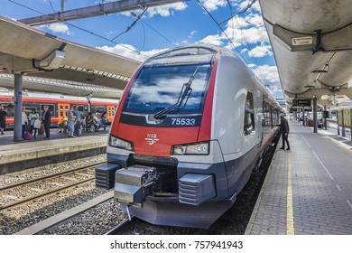 OSLO, NORWAY - JUNE 17, 2017: Platform view on Oslo central station. Oslo Central Station (Sentralstasjon) is main railway station in Oslo; from here depart trains to airport, local & regional trains.