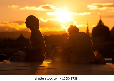 Oslo, Norway - June 20, 2014: People resting on the roof of the Oslo Opera House