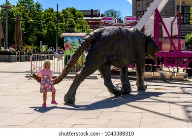 OSLO, NORWAY - JUNE 20, 2017: Unidentified children play with a tiger sculpture of Oslo, the capital of Norway