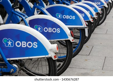 Oslo, Norway - June 20, 2019: A row of parked Obos city rental bikes in a bicycle rack.