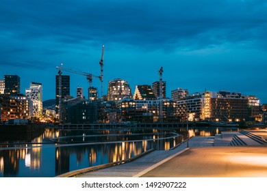 Oslo, Norway - June 25, 2019: Night View Embankment And Residential Multi-storey House On Sorengkaia Street In Gamle Oslo District. Summer Evening. Residential Area Reflected In Sea Waters