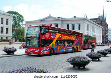 Oslo, Norway - June 26, 2018: Hop-On Hop-Off sightseeing bus near the University of Oslo. Tours on red double deckers are popular among tourists visiting main landmarks and attractions of the city.
