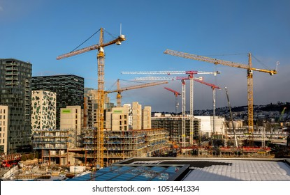 OSLO, Norway - March 16, 2018: Building site with cranes and containers in Bjorvika in Oslo, next to the Opera House.