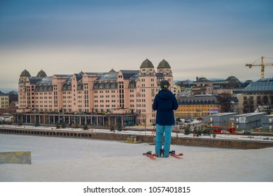 OSLO, NORWAY - MARCH, 26, 2018: Outdoor view of unidentified woman with skii clothes at Ski Jump building, located in Oslo, Norway