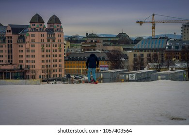 OSLO, NORWAY - MARCH, 26, 2018: Beautiful outdoor view of unidentified woman with skii clothes at Ski Jump building, located in Oslo, Norway