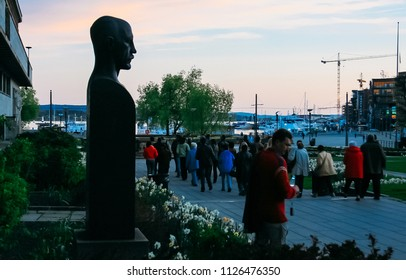 Oslo, Norway - May 01 2007: Tourists walk near bust of Fridtjof Nansen
