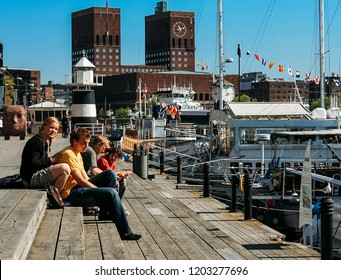 Oslo, Norway - May 02 2007: People enjoying the summer sunshine at Aker Brygge, the popular leisure district on the waterfront overlooking the marinas
