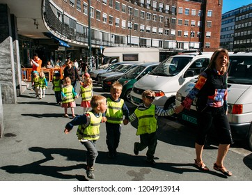 Oslo, Norway - May 02 2007: Children walking in a row on the street