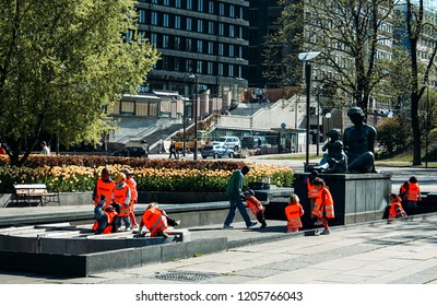 Oslo, Norway - May 02 2007: Children playing next to monument