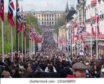 Oslo, Norway - May 17 2010: The crowd celebrating the national day and the Palace of the king.
