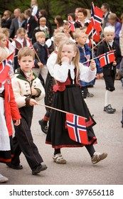 OSLO / NORWAY - May 17, 2010: National day in Norway. Norwegians at traditional celebration and parade on Karl Johans Gate street.