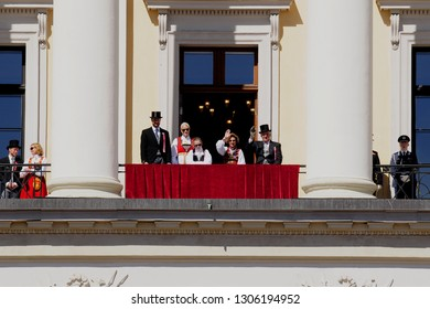 OSLO NORWAY - MAY, 17 2016: King Harald V with family greets the crowd on independence day march
