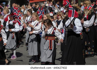 Oslo, Norway - May 17, 2016: Crowds lining the street for the Children's parade on Norway's National Day, 17th of May