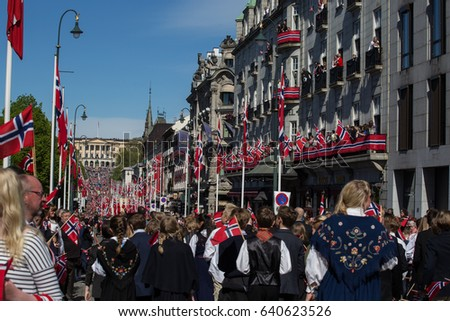 Oslo, Norway - May 17, 2016: Crowds lining the street for the children's parade on Norway's National Day 17th of May