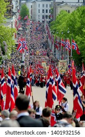 """OSLO, NORWAY - MAY 17, 2019: March on Constitution Day """"Grunnlovsdag"""".  On the streets in Oslo people celebrate freedom."""