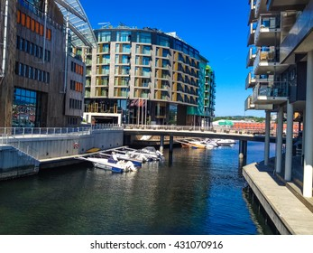 OSLO, NORWAY - MAY 28, 2014: Modern buildings at Tjuvholmen in Oslo, Norway. This former shipyard  is part of the Fjord City urban renewal program.