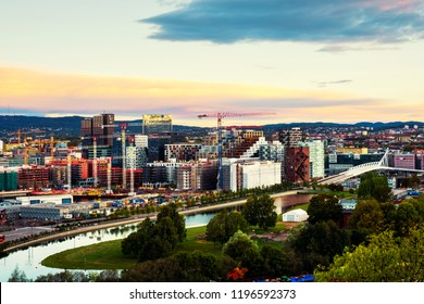 Oslo, Norway. A morning view of Sentrum area of Oslo, Norway, with Barcode buildings and the river Akerselva. Construction site with sunrise colorful sky
