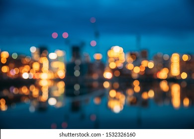 Oslo, Norway. Night Abstract Boke Bokeh Background Effect. Design Backdrop. Night View Embankment And Residential Multi-storey House In Gamle Oslo District. Residential Area Reflected In Sea Waters.