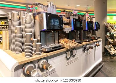 Oslo, Norway- November 12, 2018: Fresh coffee counter in 7-Eleven shop (7-11) in Oslo lufthavn Gardermoen international airport, Norway. 7-Eleven is an international chain of convenience stores