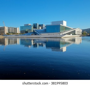OSLO, NORWAY - OCTOBER 18, 2015 : Oslo opera house - the home of The Norwegian National Opera and Ballet, and the national opera theatre in Norway. People getting on the roof to see the city view.