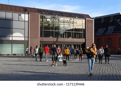 OSLO, NORWAY - SEPTEMBER 1, 2018: People outside the entrance to Oslo Central station in Norway