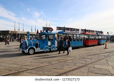 OSLO, NORWAY - SEPTEMBER 1, 2018: Street scene with the sightseeing train on Fisketorget square in Oslo, Norway