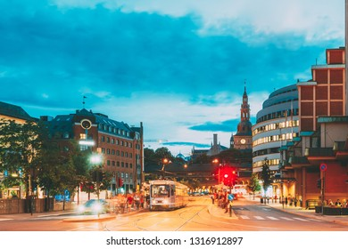 Oslo, Norway. Tram Departs From A Stop On Biskop Gunnerus Gate Street. Street In Centrum District In Evening Or Night Illumination.