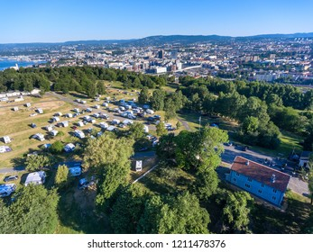 "OSLO, NORWAY-CIRCA JUL, 2018: Flight above the Ekeberg a neighborhood of Oslo city with great view at cityscape. Urban campsite Ekeberg ""City camp"" is on hill."