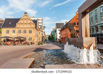 Oslo, Norway-July 26, 2013: a Hansen fountain glove with a sculpture of the hand of king Christian IV indicating the location of the new city on Christiania Torv square in Kvadraturen. Monuments and