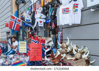 Oslo, Norway-July 26, 2013: Merchants on the street in Oslo, Norway. Migrants sell Souvenirs to tourists on trays.