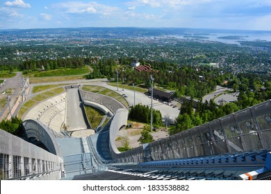 Oslo, Norway-May 2020; High angle view from the top of the futuristic ski jump Holmenkollbakken looking down to the seating area and the city of Oslo