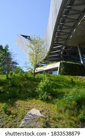Oslo, Norway-May 2020; Low angle view of the top of the futuristic ski jump Holmenkollbakken against a blue sky