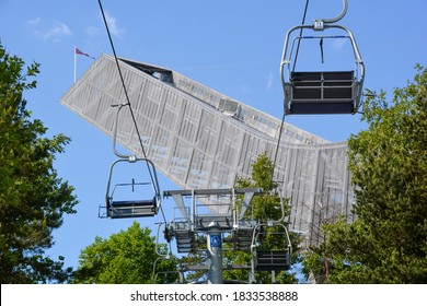 Oslo, Norway-May 2020; Low angle view of the top of the futuristic ski jump Holmenkollbakken with chair lift in front
