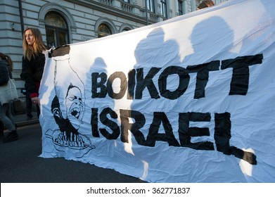 "OSLO - OCTOBER 17: Activists hold a banner reading ""Boycott Israel"" during a protest in solidarity with Palestine near the Israeli embassy in Oslo, Norway, October 17, 2015."