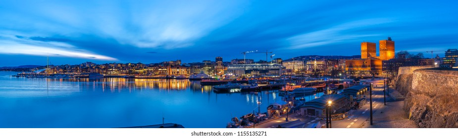 Oslo panorama night city skyline at Oslo City Hall and Harbour, Oslo Norway