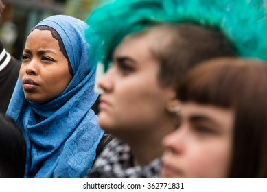 OSLO - SEPTEMBER 12: A Muslim woman wearing a hijab headscarf stands side by side with a punk woman with a green mohawk at a rally in support of Syrian refugees, Oslo, Norway, September 12, 2015.