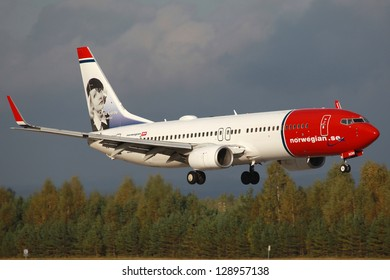 OSLO - SEPTEMBER 16: A Norwegian Boeing 737-800 on approach on September 16, 2012 in Oslo. Norwegian is a low-cost carrier which operates with 64 aircraft and carried 15.7 million passengers in 2011.