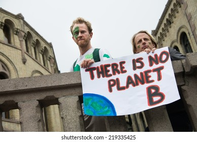 "OSLO - SEPTEMBER 21: Men hold a sign reading, ""There Is No Planet B"", as thousands march through downtown Oslo, Norway, to support action on global climate change, September 21, 2014."