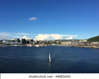 The Oslo skyline and opera house, a sunny day in july 2016.