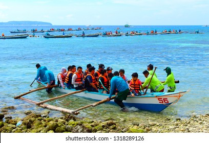 Oslob, Cebu, Philippines - October 2, 2018: A group chinese tourists near the shore is going to swim and watch whale sharks. Popular attraction among tourists from around the world.