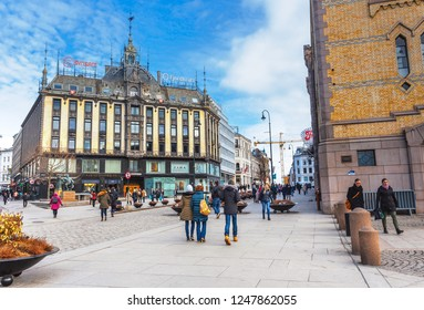 OSLO,NORWAY - MARCH 26,2018 : Tourist walking in the Karl Johans Gate shopping street in summer