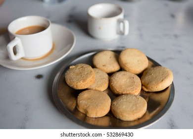 Osmania Biscuits and Irani Chai on white marble background in Hyderabad,India