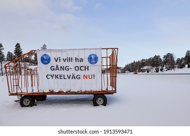 """Osmo, Sweden A sign on a haywagon in the snow in Swedish saying: """" We want a walking and bike path now!"""""""