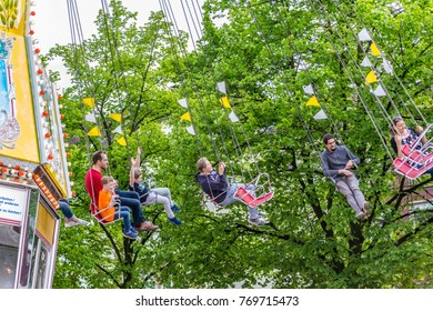 Osnabrueck / Germany - 05/15/2017: People riding the swing ride in a spring festival fairground