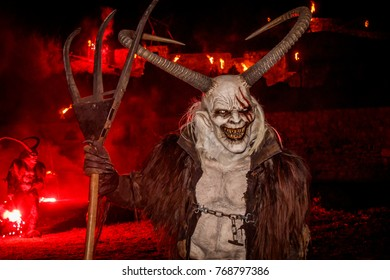 OSOPPO, ITALY - DECEMBER 2, 2017: The Krampus' raid, Germanic folklore public event, held in early December in the Alpine regions, in which demons chase children who have misbehaved to punish them