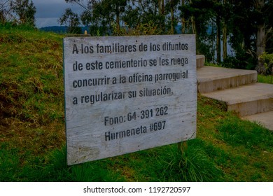 OSORNO, CHILE, SEPTEMBER, 23, 2018: Outdoor informative sign over a wooden structure located in the cemetery of Puerto Octay, Chile