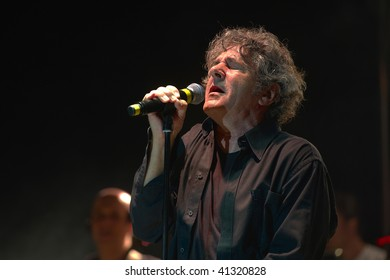 OSPITALETTO, ITALY - JULY 27 : Italian pop singer Fausto Leali performs during live concert on July 27, 2009 in Ospitaletto, Italy.