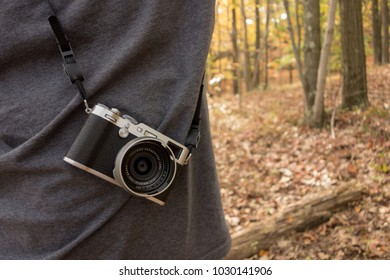 Ossining, New York, USA - CIRCA October 2017:  Hiker carrying the retro styled Fujifilm X100F Digital Camera.